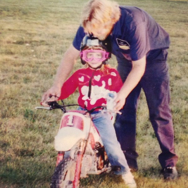 Photo of my dad teaching me to ride at age 4 on a PW-50